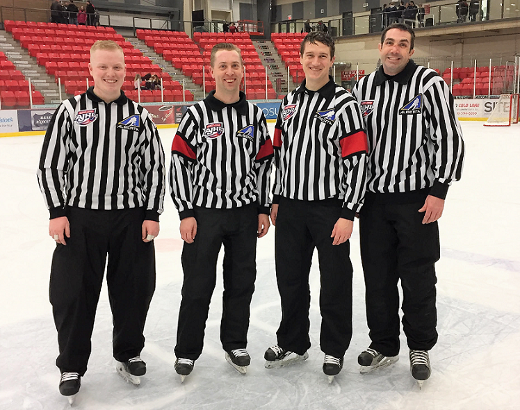 Brent Young, Danny Gadowski, Kurt Caron, and Chad Marchand working the World Jr A Challenge